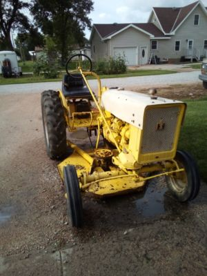 1; 1968 International Cub riding mower with a 4ft. belly mower